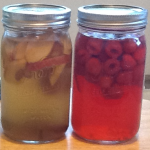 Just combined on the right: apple, dried apricot, ginger and a cinnamon stick; you can see the honey on the bottom. On the right: raspberries and a ginger slice.