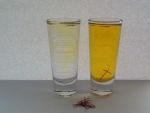 Left. Saffron that has steeped for 2 minutes. Right: Saffron tea. Center: a generous pinch of saffron